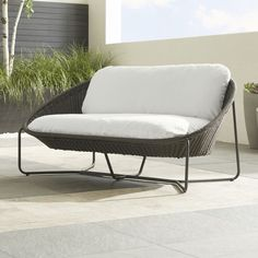 Morocco Charcoal Oval Loveseat with Cushion - Crate and Barrel