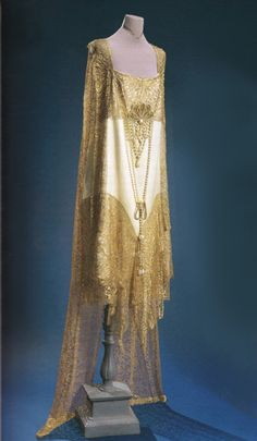 Ivory satin and gold lace evening dress, 1920s.