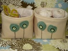 Fabric bins made of up-cycled wool. Pretty and simple flowers on the front. Inspiring pic.
