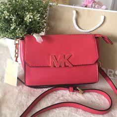 Michael Michael Kors Florence Crossbody Brand New With Tag; 100% Authentic; MMK Florence Leather Crossbody; style #35H5GREC1T; Gold tone hardware; Zip closure; Exterior: 1 pocket on front,1 back slit pocket; Flap closure; Interior:1 zip pocket,3 cc slots; MK Logo print lining; Watermelon; All my MMK handbags & Wallet will be shipped with beautiful MK shopping bag/papper bag while supply last... MICHAEL Michael Kors Bags Crossbody Bags
