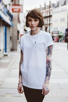I love that this girl is so chic and Audrey-looking, yet has all these tattoos! | Le #bob