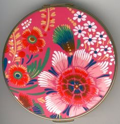 Stratton compact has a funky 60s or 70s floral design in deep pinks