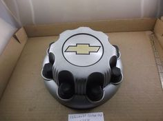 Chevy1500HD 2500 3500  center cap hubcap 0em 8 lug. (Silver in color ) J338…