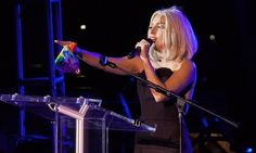 Lady Gaga points to the crowd at the New York City gay pride parade 2013
