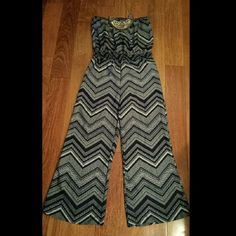 Chevron Jumpsuit Strapless Navy blue and white chevron print elastic gathered waist.   28 in imseam Other