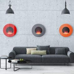 """This fun and whimsical modular fireplace is the first of its kind. Its circular shape adds a modern touch to any space, while the simple yet elegant crystal embers and glowing LED backlight will set the mood to cozy. These coloured-glass wall-mounted fireplaces comes in red, orange or grey, and can be displayed as a set (mix and match colours) or individually. These compact units hang neatly on your wall with a depth of less than 5"""", the slim design makes it discreet while blending…"""