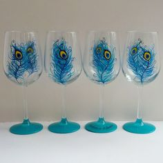 Peacock party hand painted wine glasses by GlassesbyJoAnne on Etsy