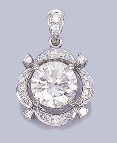 A DIAMOND PENDANT   Set with a circular-cut diamond weighing 5.14 carats in a circular-cut lotus surround to the diamond-set pendent hoop