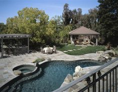 Gorgeous freeform swimming pool with gray stone patio in lovely backyard. Swimming Pool House, Luxury Swimming Pools, Indoor Swimming Pools, Swimming Pool Designs, Small Backyard Landscaping, Backyard Ideas, Pool Ideas, Pergola Ideas, Backyard Pools