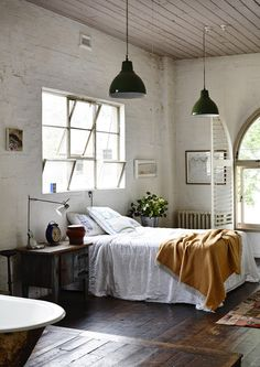 Warm, very wooden and brick bedroom space.