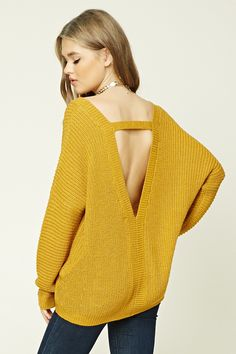 A ribbed knit sweater featuring a V-neckline, a strappy V-cutout back, dropped long sleeves, and a ribbed hem.