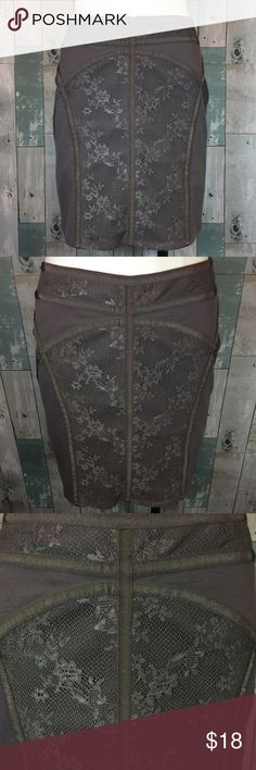 Free People skirt Excellent condition!! 17.5 inches in length. Waist measures 31 inches. Zippers up in left side. Body is 70% polyester, 25% rayon and 5% spandex. Lace is 100% nylon. Smoke free and pet free home! Free People Skirts Mini