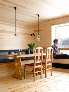 VIEW INSIDE: The chairs came with the cabin, and stay here until the family finds something they think fits better. Roof pendants are from Northern Lighting. Modern Cabin Interior, Interior Design, Cabin Design, House Design, Indoor Places, Swedish Cottage, Bohinj, Timber Panelling, Rooms For Rent