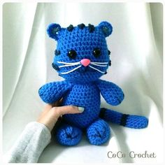 This adorable Tiggie stuffed animal features permanent safety eyes and safety nose. He is about 14 tall and is very soft and cuddly.
