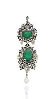 A LATE 19TH / EARLY 20TH CENTURY EMERALD AND DIAMOND BROOCH / PENDANT. The surmount with fancy-cut emerald and single-cut diamond cluster centre, to a fruiting vine surround, composed of bunches of seed pearl grapes among old-cut diamond-set vine leaves, suspending a pear shaped emerald drop with similarly-set seed pearl and diamond border, to a further briolette-cut diamond terminal, mounted in silver and gold.