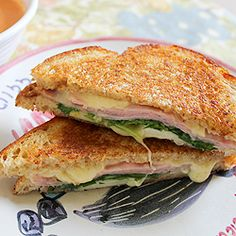 Grilled ham and gruyere cheese sandwiches, pressed with thin slices of pear