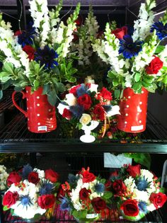 """Make your guests """"Oooh"""" and """"Aaah"""" with these red, white and blue centerpieces. Or let our talented designers customize an arrangement just for you."""