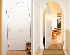 Painted curved metal door at the entrance Home Renovation On A Budget Brings Together Style And Sustainability