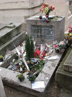 "Jim Morrison's grave - Morrison is buried in the Père Lachaise cemetery in eastern Paris, with the Greek inscription: ΚΑΤΑ ΤΟΝ ΔΑΙΜΟΝΑ ΕΑΥΤΟΥ, ""true to his own spirit."" ~ This photo was taken on December 31, 2007 in Paris, Ile-de-France, FR."