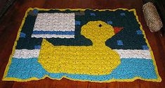 Just Ducky Cuddle quilt. Here's the link to my finished blanket on Ravelry: http://www.ravelry.com/projects/Sexymayo/just-ducky-cuddle-quilt