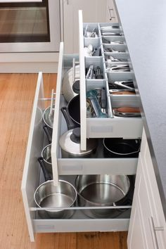 Keep your kitchen in order with our pot drawers and cutlery drawers! Visit http://kaboodle.com.au for more inspiration.