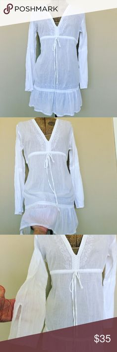 White cotton dress boho chic swimsuit cover Bell S Absolutely beautiful and so Feminine! Pre-owned. I've had this beautiful piece for over 10 years and I wore it once, hand washed and hung to dry. Great condition! Size small. Adjustable tie under bust. 100 % cotton. Sheer. Bust 20 in Length: 31. Deep v and beautiful embroidered detail . Slight flare bell sleeve.  TAGS # bohemian gypsy swimwear sundress shabby chic vintage loungewear mini Long sleeve Lace ruffles Surface Dresses Mini