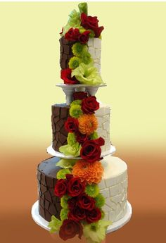 two tone wedding cake, one white cake, one chocolate cake, great for those who cannot agree with cake taste! beautiful red roses flowers flow from top to bottom .... more cool pins at  http://www.Pinterest.com/jazevox