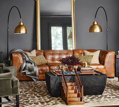 Boxy, tufted, 70s-inspired seating is trending right now. Usually leather, but not always. Like a classic chesterfield and a Ligne Roset Toga had a baby that went Alex P. Keaton and stiffened up. O…