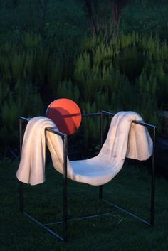 Sunset Armchairsculture made by hand fromwood and black steel