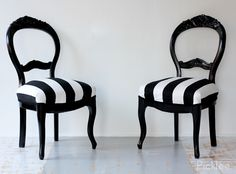 Love these chairs redone in black and black and white fabric seats. So pretty.
