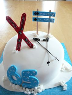 A vanilla cake with strawberry jam and buttercream covered with fondant for a huge ski fan! All edible except for the wood sticks that hold the alpine ski-run name. The skis and all details are hand painted on fondant. I used spaghetti pasta for the ski-sticks that I painted with food color, it works very well!