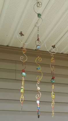 wind chime sun catcher window charm wire wrapped marbles wire work beaded spinning hand made by me Wire Crafts, Bead Crafts, Mobiles, Diy Wind Chimes, Outdoor Crafts, Wind Spinners, Wire Art, Beads And Wire, Hanging Art