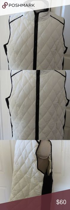 "Calvin Klein Vanilla With Black Trim Vest, 1X You are purchasing new with tag Calvin Klein vanilla with black trim vest, 1x.  There is one slight mark on the back of the neck, please see pictures.  Length 26"" Pit to pit 21"" Sleeveless  D64  MRSP $99.50 Calvin Klein Jackets & Coats Vests"