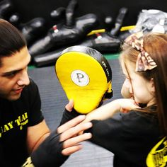 Coach Rehan making adjustments with one of our young ladies learning to throw a Lead Hook Elbow!  Visit tagmuaythai.com and follow us @tagmuaythai #muaythai #thaiboxing #kidsmma #kidsmartialarts #girlpower