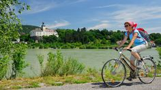 Saddle up: cycling along the Danube with Persenbeug Castle in the background. #SMH