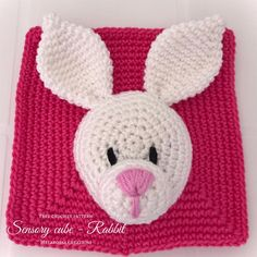This cube face is composed by a raspberry square ( color code on which will be sewn the rabbit head ( in white color code 106 ). The rabbit consists of head, muzzle and two ears. Easter Crochet Patterns, Crochet Basket Pattern, Crochet Square Patterns, Baby Knitting Patterns, Baby Patterns, Crochet Game, Crochet Baby Toys, Simply Crochet, Single Crochet Stitch