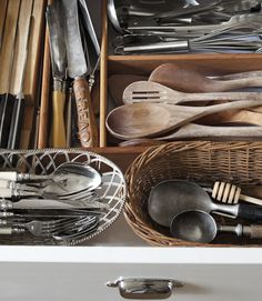 Love the antique wooden spoons and the way the utensils are organized.  Beautiful and practical.