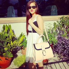 #gunasgirl carrying her Miss Betty bag 100% vegan