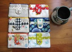 Little zip wallets or pouches with the cutest detailing on it. There's a tutorial for that one and several other cute bags.