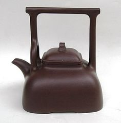 Chinese purple clay yixing teapot. with mark at the base and inside the lid. 14cm wide.14,2cm high. Good condition with two small chipped at the lid