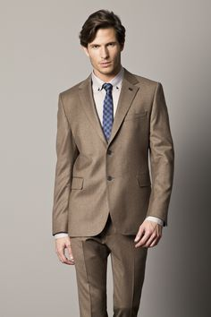 Dark brown suits look nice with a lighter reddish contrast. Bold ...