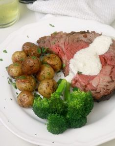 Preparing the Perfect Prime Rib is EASY!  Also called Standing Rib Roast, this impressive cut of beef is melt in your mouth tender and juicy. The prime rib is slow-cooked to a perfect medium rare and the roasted herb crust is nothing short of amazing.  #Slow roasted prime rib #Easy prime rib recipe #Best Standing Rib Roast #Kitchen Dreaming