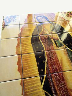 """A new tile mural available now in my Etsy Store. The #Virgin of #Guadalupe - Big size tile mural composed by 35 ceramic tiles - 100% #handmade in Italy - Suitable indoor and outdoor. Perfect for a prayer room, for a niche outdoor, or simply hung on the wall (the mosaic can arrive """"ready to hang""""). Free shipping to selected countries. https://www.etsy.com/listing/493374468"""