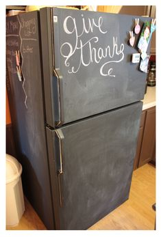 Fridge painted in chalkboard paint. Love this idea for when you can't afford a nice looking fridge. Have fun with it!