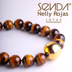 """¡Ojos de tigre para tu cuello! Nelly Rojas ha diseñado especialmente para ti este hermoso collar corto de cuentas """"ojo de tigre"""" con dije en plata y baño en oro.  http://www.elretirobogota.com/esp/?dt_portfolio=senda"""