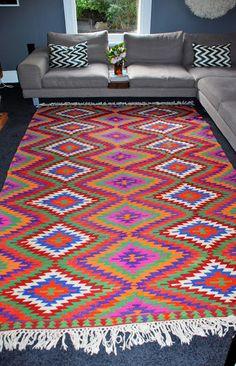 gray wall bright kilim rug