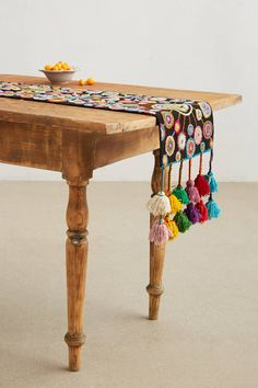 LOVE tassels.  Turned Petals Table Runner - anthropologie.com