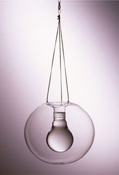 'Sapphire light' by Paul Cocksedge, 2004, glass, steel and UV LED: Gin and tonic poured into a light bulb-shaped vessel and UV light shining onto the chandelier, the liquid changes from being crystal clear to an incredible glowing blue.