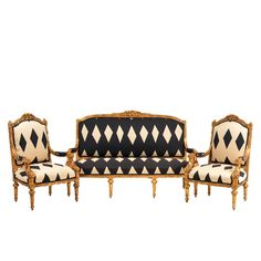 Daphney Navy Couch at Found Vintage Rentals. Gold framed couch with cream and navy upholstery