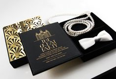 "A Gatsby-themed party invitation with ""Pearls for Girls"" and ""Ties for Guys"". Designed to mimic the classic novel, the invitation was constructed with a gold chrome cover and a velvet box with interior trays for styling the flapper and the dapper."
